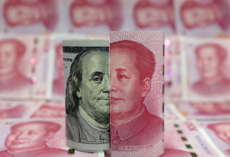 Guarding Stability, China Likely to Slow Yuan's Slide to 7 Per Dollar - Reuters Exclusive