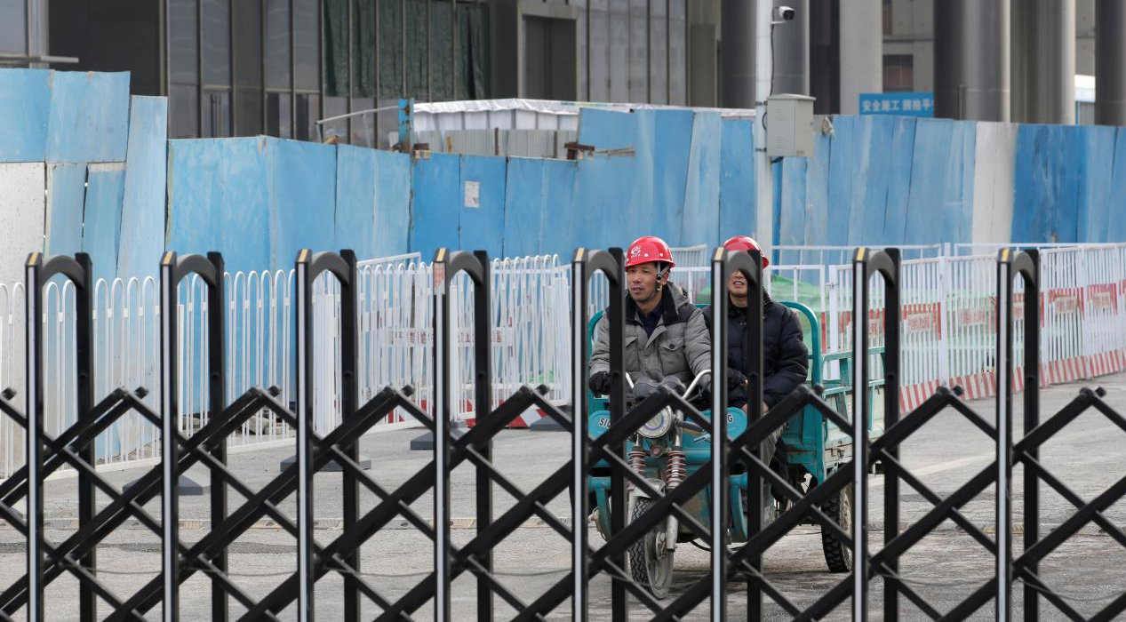China's Growth Slowed by Service, Farm Sectors, Despite Construction Rebound