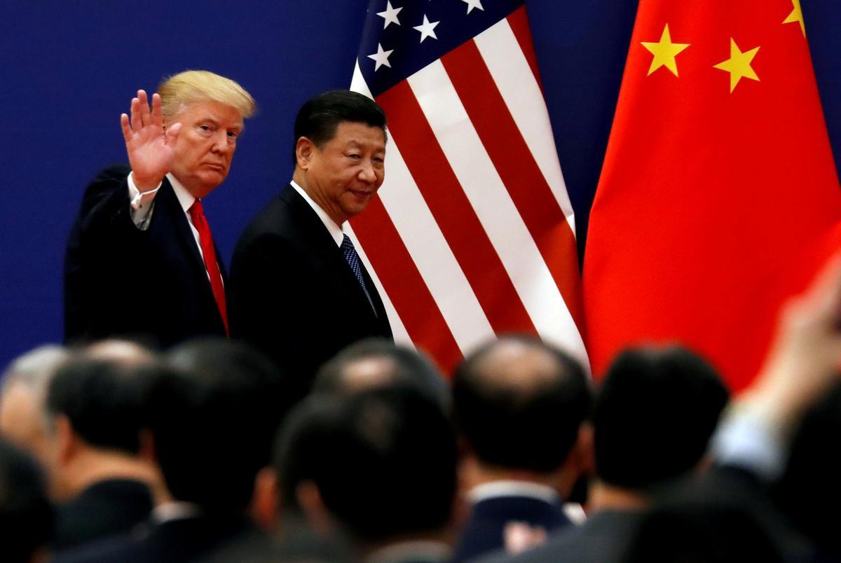 Trump to Meet Xi After Defiant China Slaps U.S. With New Tariffs